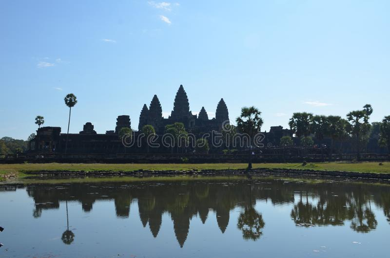 The Angkor Wat temple with five towers is reflected in the lake. Angkor, Cambodia royalty free stock images