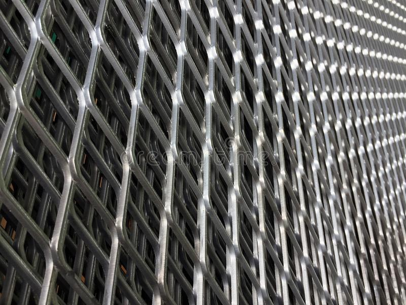 Angle of constricted of metal grille. pattern of Steel grating. It is a framework of spaced bars that are parallel to or cross each other. Use for wall, fence royalty free stock images
