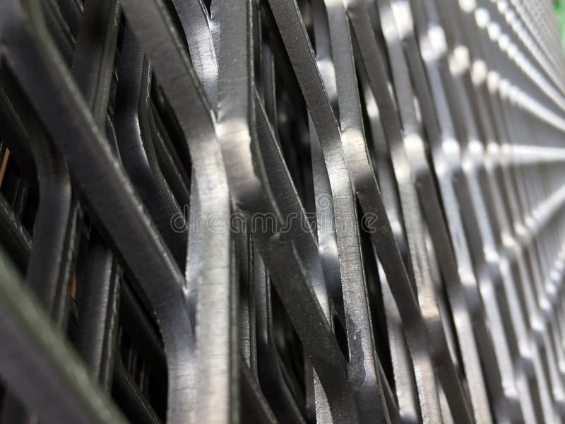 Angle of constricted of metal grille. pattern of Steel grating. It is a framework of spaced bars that are parallel. Angle of constricted of metal grille royalty free stock images