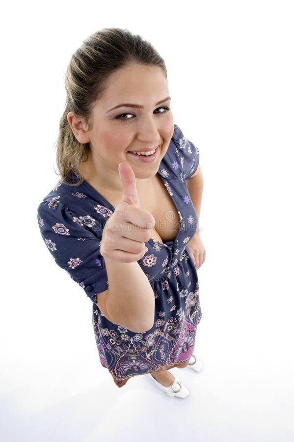 angle flickahighen som visar tumen upp siktsbarn arkivfoto