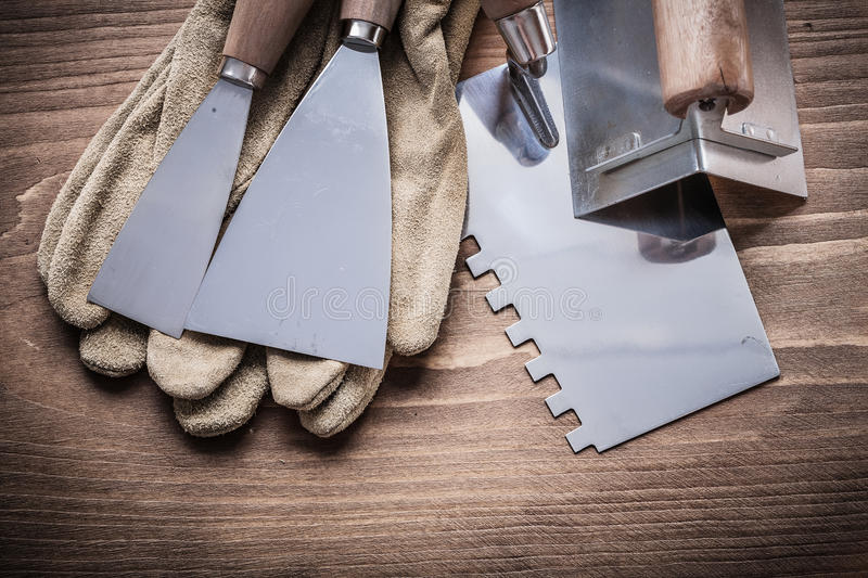 Angle former two paint scrapers working gloves putty knife.  royalty free stock photos