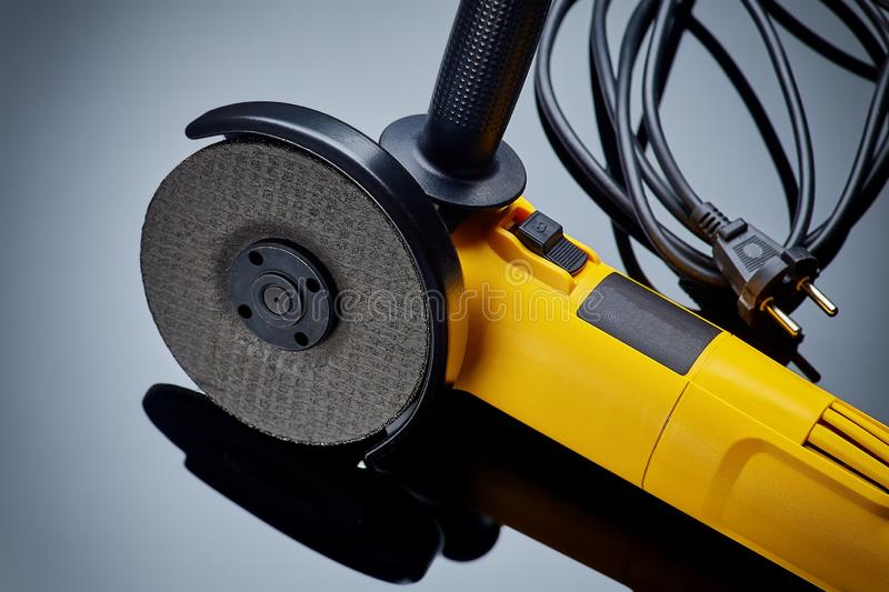 Angle grinder for metal on dark background close-up stock image