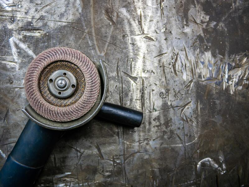 Angle grinder on the table. Metal processing.  royalty free stock photos