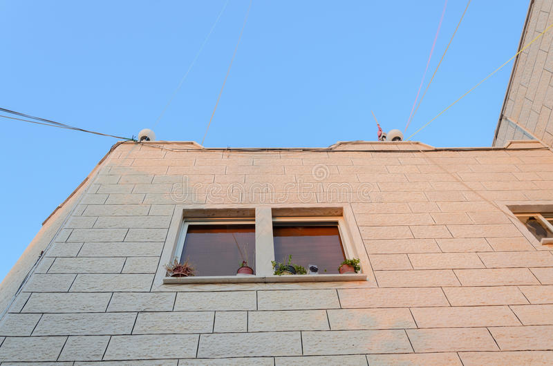 The angle of a new residential building with a window on a blue sky background stock photo