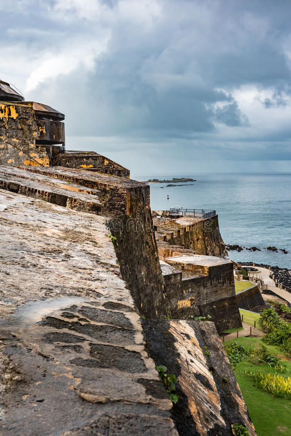 Angle view of Castillo San Felipe del Morro. Wall looking to castle point with stormy sky stock photography