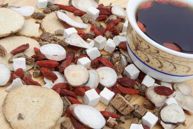 Angle view chinese herbs blends and herb tea. On wood stock images