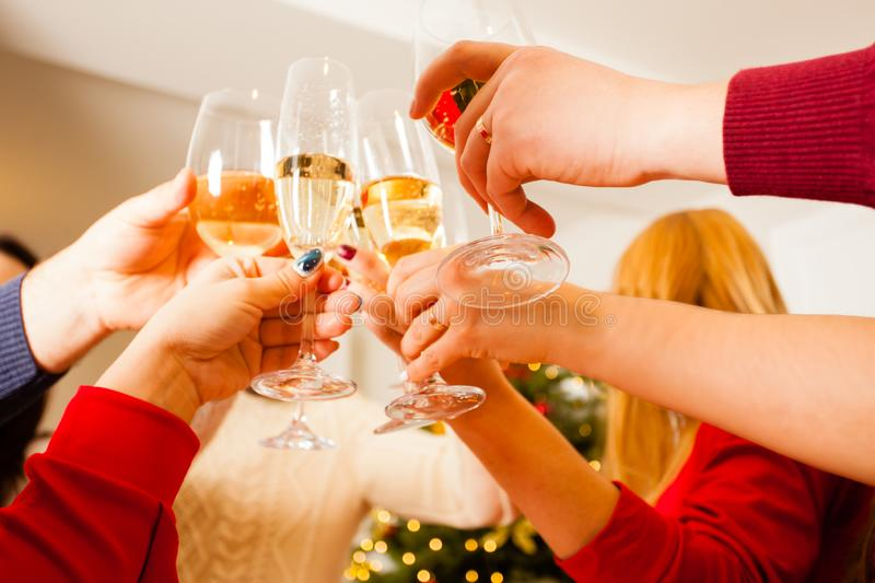 Angle view of hands of people toasting and cheering stock photo