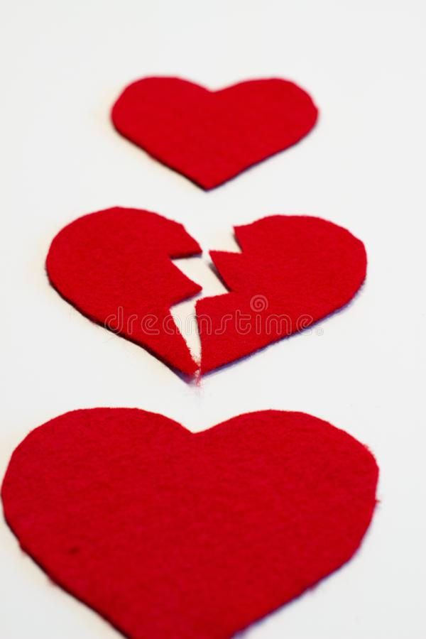 Angle view of three red felt hearts one broken stock image
