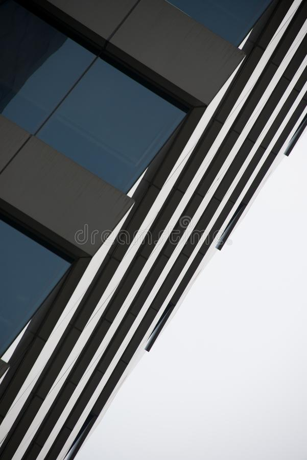 Angled corner of glass and concrete skyscraper. Angled corner of a glass and concrete skyscraper royalty free stock photo