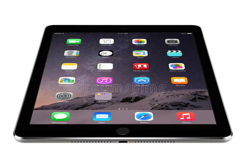 Angled front view of Apple Space Gray iPad Air 2 with iOS 8 lies royalty free stock photography
