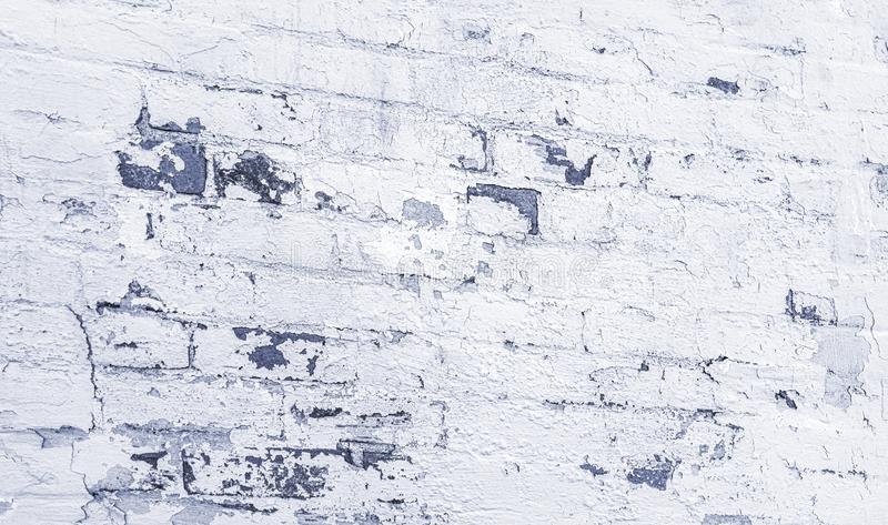 Angled perspective high resolution tinged gray grey brick wall white peeling paint background stock photo