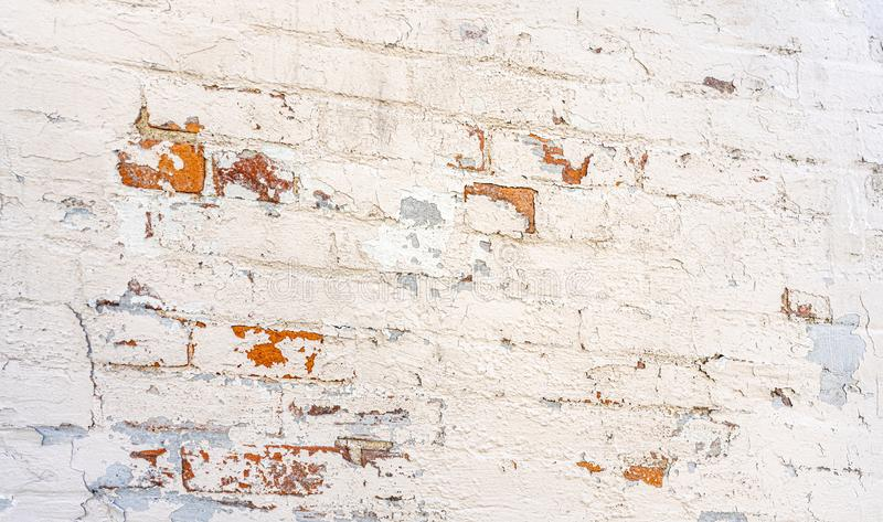 Angled perspective high resolution terracotta red brick wall white and blue peeling paint background royalty free stock photography