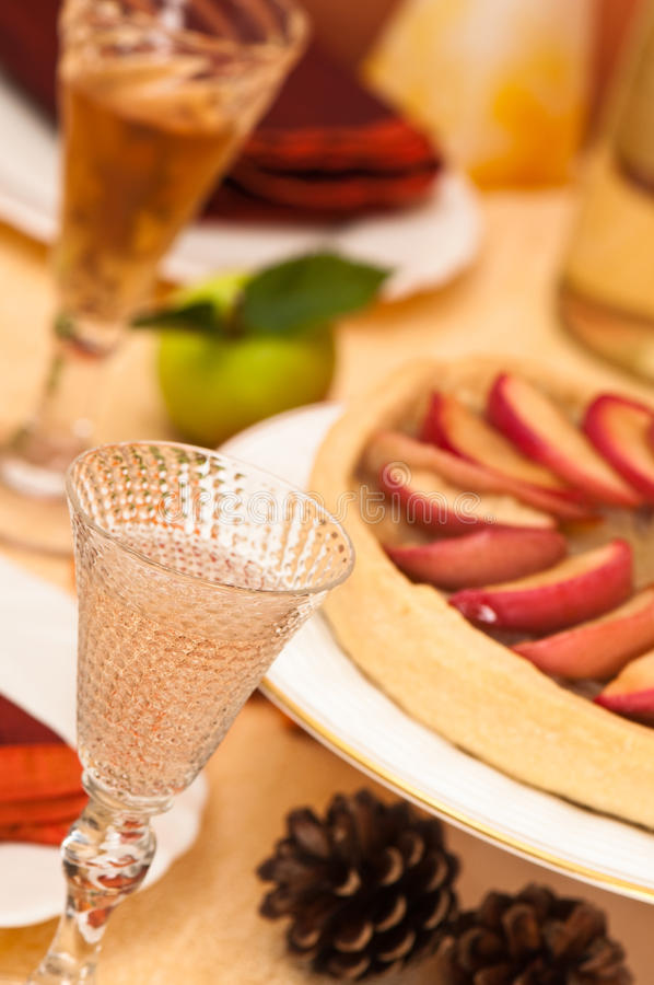 Angled Thanksgiving Table Setting. Thanksgiving table setting with white wine and dessert stock photos