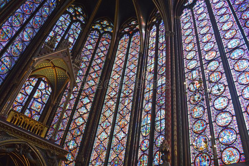 Angled view Beautiful stained glass windows in the upper level interior Sainte-Chapelle Paris France. Angled view of Stained Glass windows at the upper level stock photos