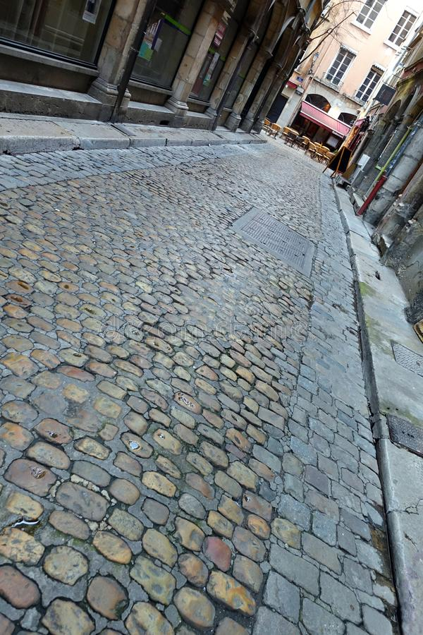 Street in Lyon, France. Angled view of an empty cobble stone street in Lyon, France royalty free stock image