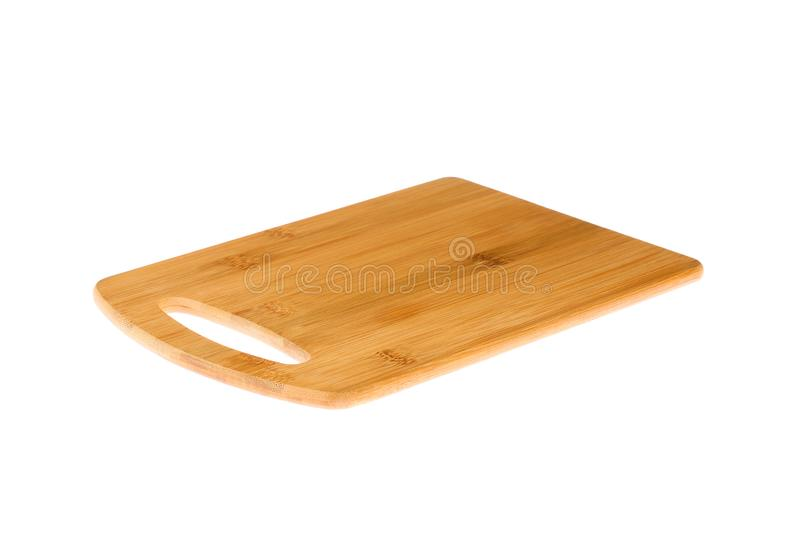 Angled view of a new, empty wooden cutting board, isolated on a white background royalty free stock images