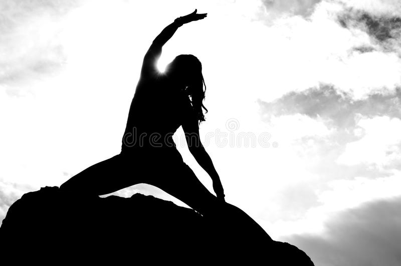 Angled Warriors Pose Silhouette royalty free stock image