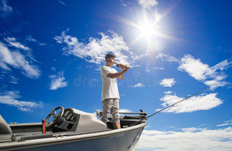 Mature man on a motor boat. Fishing royalty free stock images
