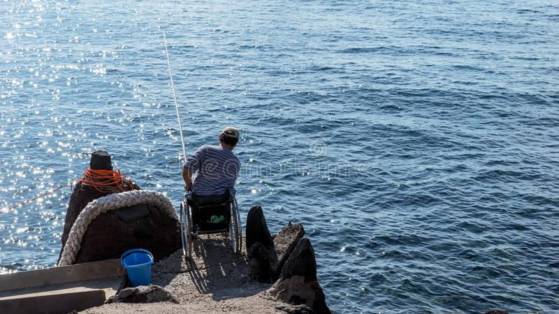 Disabled Man On Wheelchair Fishing In Nature Stock Image