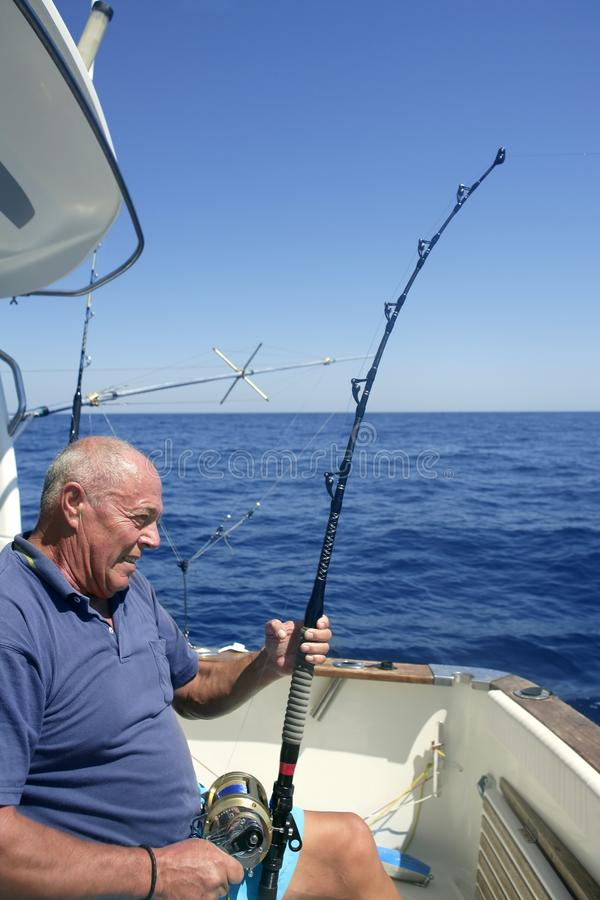 Angler senior big game sport fishing boat royalty free stock photos