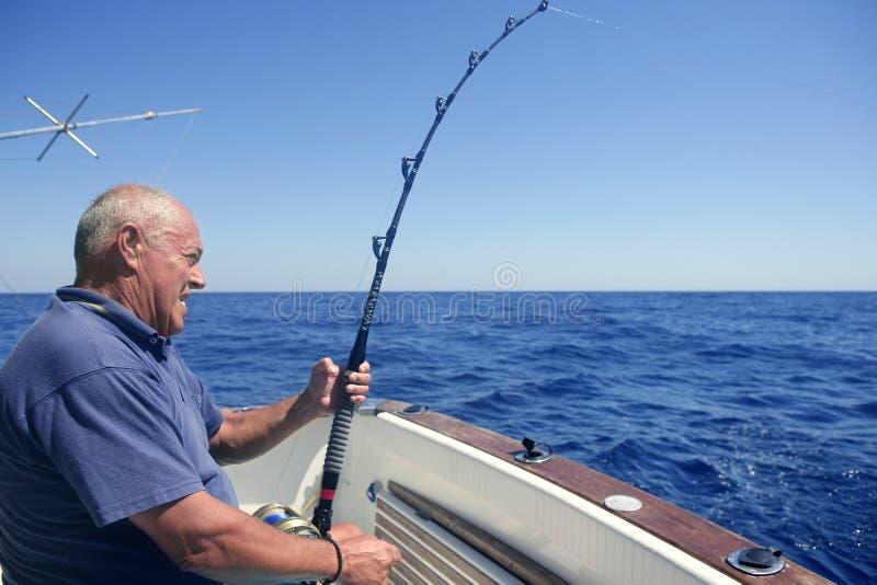 Angler senior big game sport fishing boat stock photo for Fishing boat games