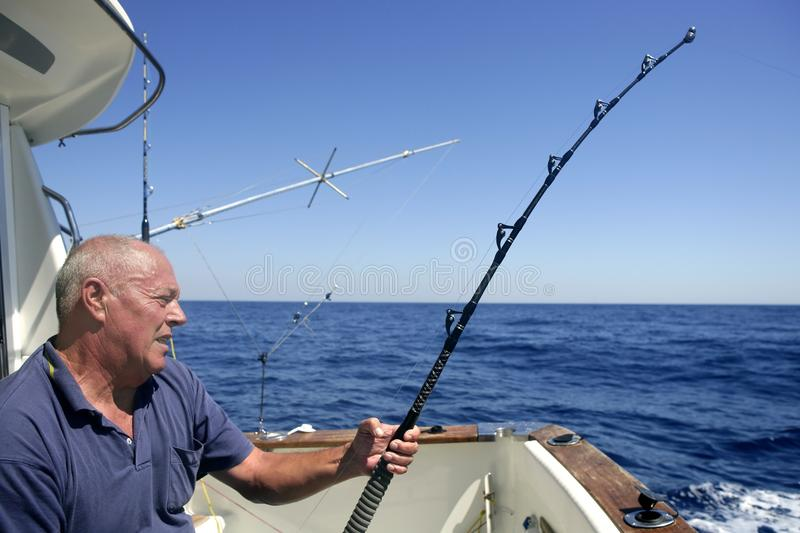 Angler senior big game sport fishing boat stock photography
