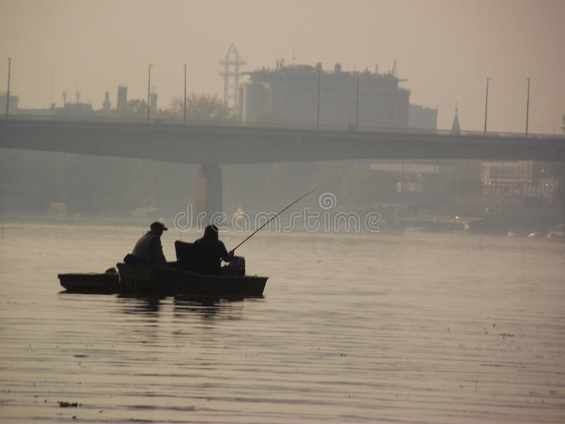 Anglers on the river stock photo