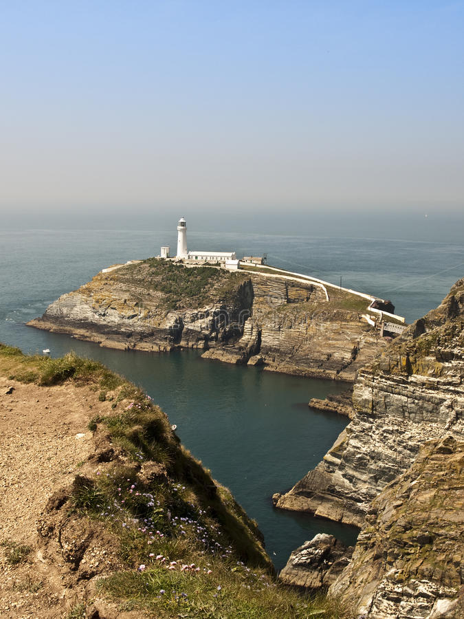 Anglesey coast lighthouse Wales. Anglesey coast south stacks lighthouse North Wales stock photo