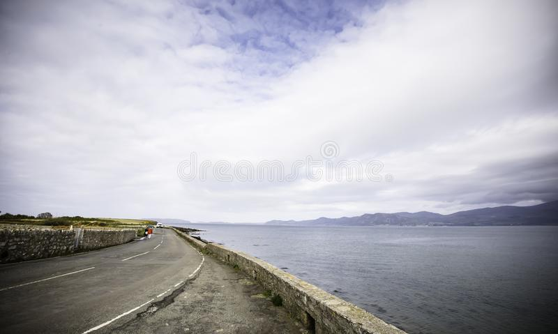 Anglesey landscape,dramatic,cloudy sky over countryside road. royalty free stock images
