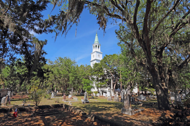 The Anglican parish church of Saint Helena in Beaufort, South Ca. Spire and graveyard framed by Spanish moss-covered trees at the parish church of St. Helena in royalty free stock photo