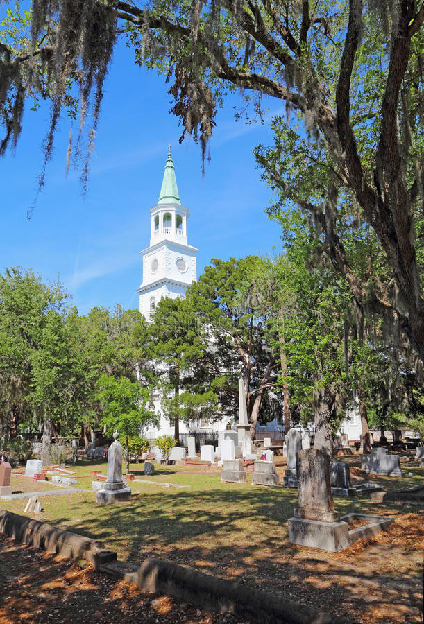 The Anglican parish church of Saint Helena in Beaufort, South Ca. Spire and graveyard framed by Spanish moss-covered trees at the parish church of St. Helena in royalty free stock images