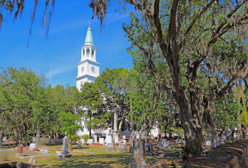 The Anglican parish church of Saint Helena in Beaufort, South Ca. Spire main building and graveyard framed by Spanish moss-covered trees at the parish church of royalty free stock photos