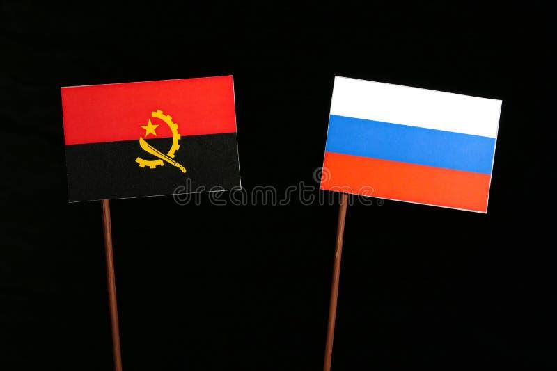 Download Angolanische Flagge Mit Der Russischen Flagge Lokalisiert Auf Schwarzem Stockbild - Bild von geschäft, konkurrenz: 96931923
