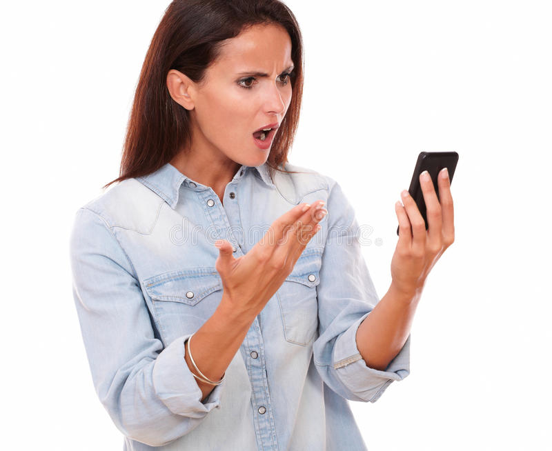 Angry adult female reading a message royalty free stock photos