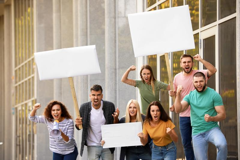 Angry African-American woman with megaphone leading protest. Angry African-American women with megaphone leading protest outdoors royalty free stock photo