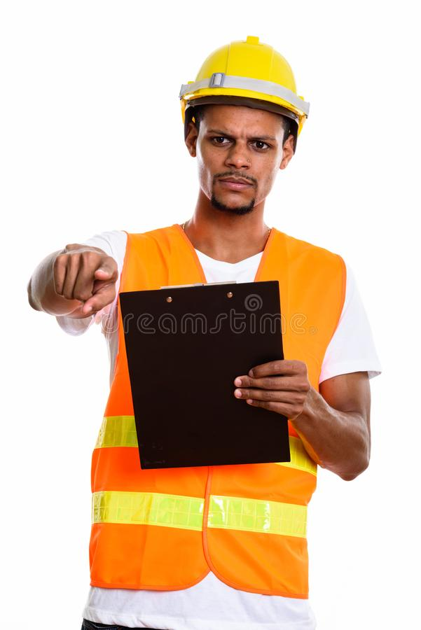 Angry African man construction worker holding clipboard while po royalty free stock photos