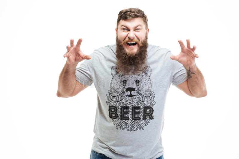 Angry agressive bearded man shouting and frightening stock photo