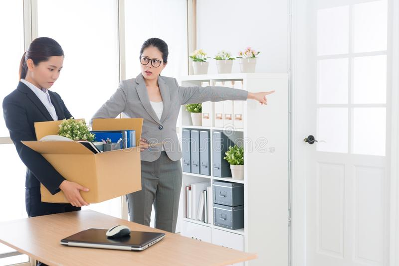 Angry annoyed company manager woman fired employee stock photography