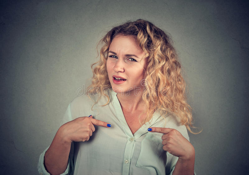 Angry annoyed woman asking you talking to me?. Angry, unhappy, annoyed young woman, getting mad, asking question you talking to me, you mean me? Isolated gray stock photos