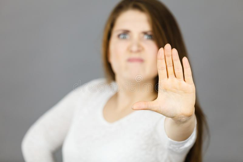 Angry apodicticity woman showing stop with hand royalty free stock photos