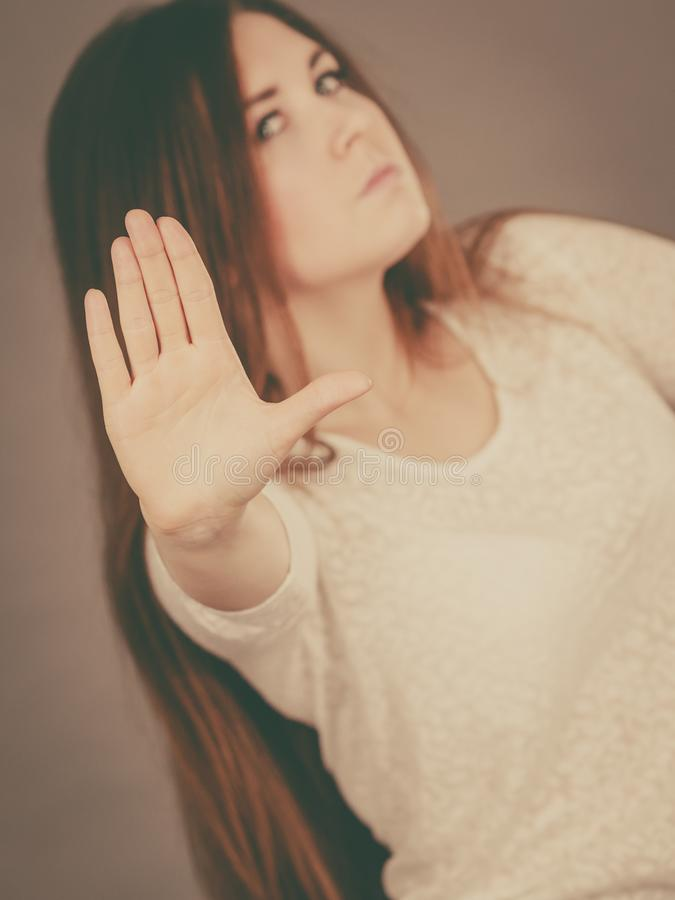 Angry apodicticity woman showing stop with hand stock photos