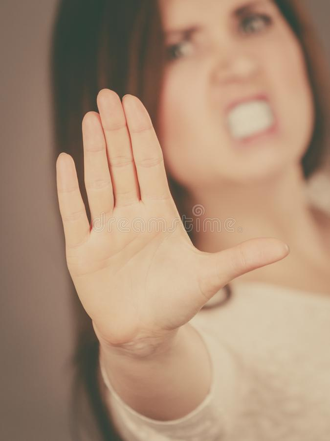 Angry apodicticity woman showing stop with hand royalty free stock image