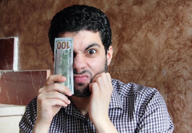 Angry arab young businessman with dollar bill money stock photography