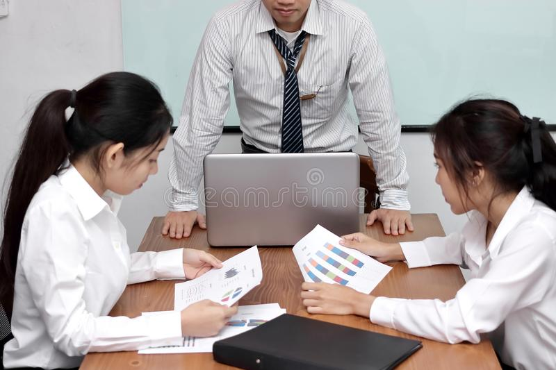 Angry Asian boss man complaining employee during meeting in conference room. stock images