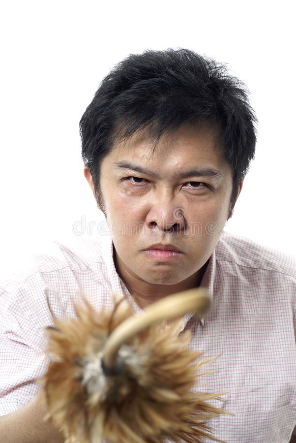 Download Angry Asian With Feather Cane Stock Image - Image: 10490567