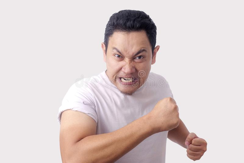 Angry Asian Man Expression Ready to Fight stock photography