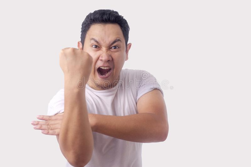 Angry Asian Man Expression Ready to Fight royalty free stock photo