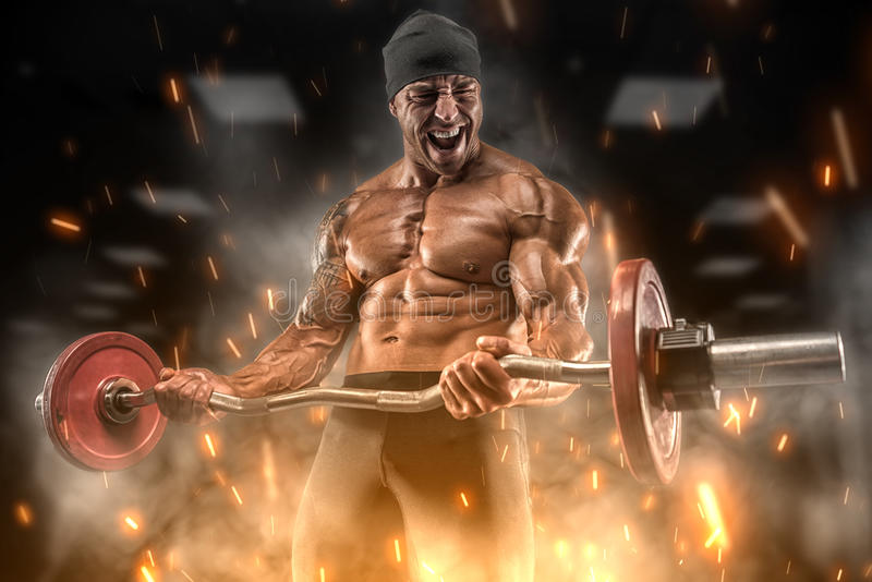 Angry athlete trains in the gym. Big angry athlete trains in the gym
