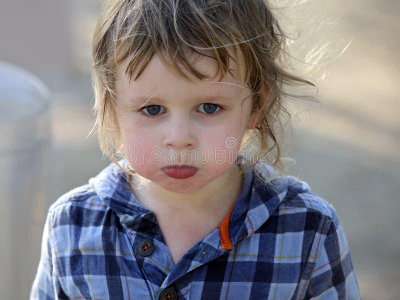 Angry baby boy stock image