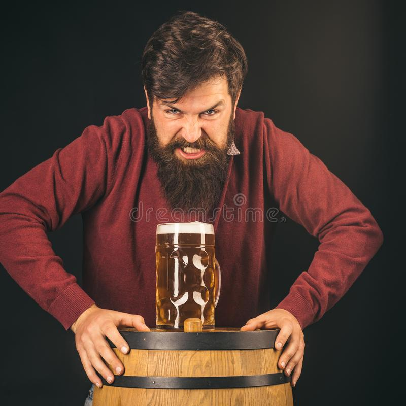 Angry Barman. Brewery concept. Beer in the US. The celebration oktoberfest festival concept.  stock photos